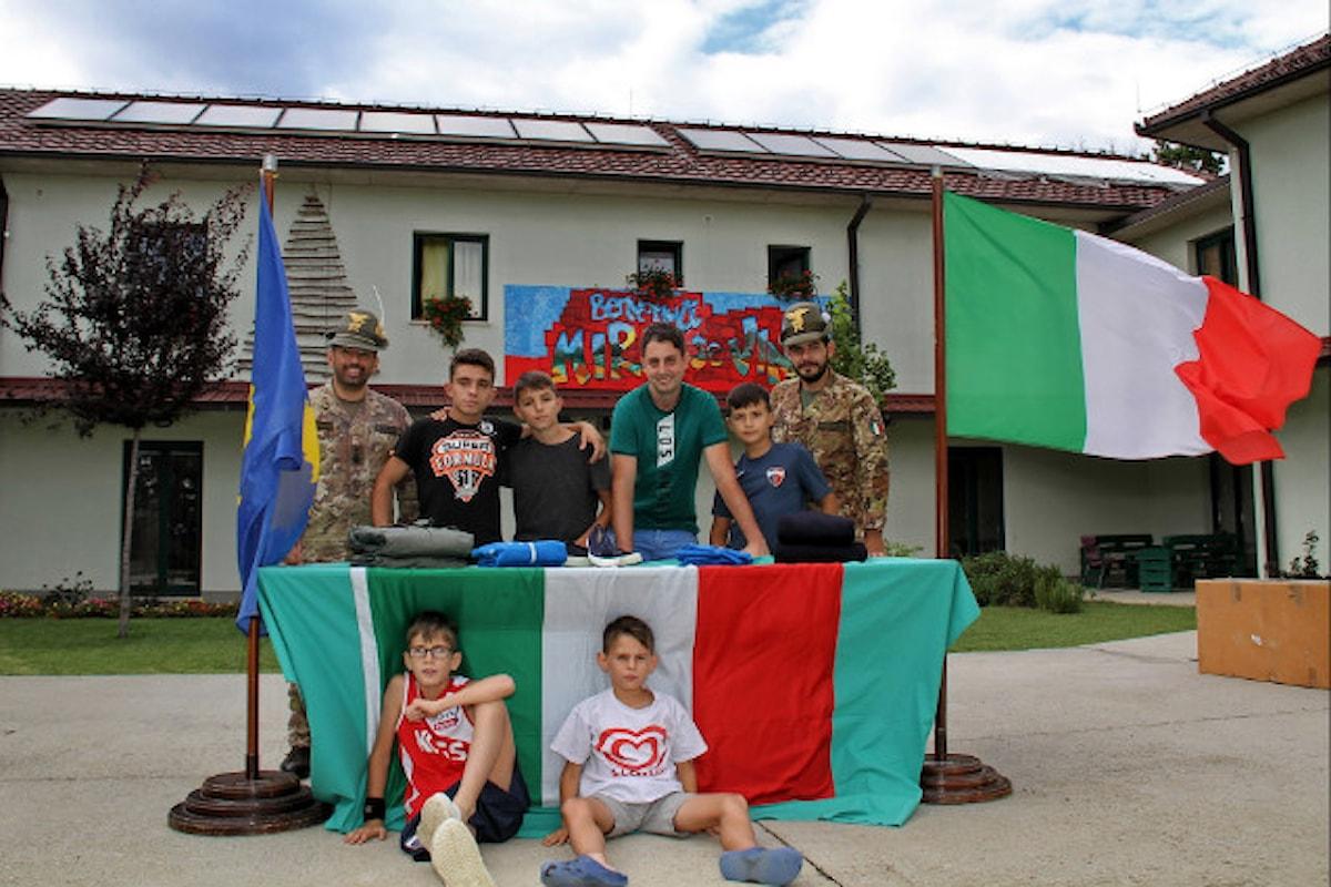 Kosovo, militari italiani donano capi di vestiario a ragazzi orfani di una casa famiglia
